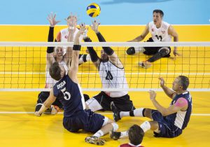 Eric Duda, second from left, of The United States, spikes over the block of Canada's Doug Learoyd, left, and Jesse G. Buckingham, centre, during sitting volleyball semifinal action at the 2015 Parapan Am Games in Toronto on Thursday, August 13, 2015. Canada lost to USA 1-3. THE CANADIAN PRESS/Darren Calabrese